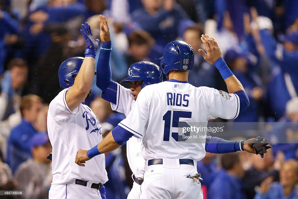 <a gi-track='captionPersonalityLinkClicked' href=/galleries/search?phrase=Alcides+Escobar&family=editorial&specificpeople=4845889 ng-click='$event.stopPropagation()'>Alcides Escobar</a> #2 of the Kansas City Royals and <a gi-track='captionPersonalityLinkClicked' href=/galleries/search?phrase=Alex+Rios&family=editorial&specificpeople=224676 ng-click='$event.stopPropagation()'>Alex Rios</a> #15 of the Kansas City Royals celebrate with Kendrys Morales #25 of the Kansas City Royals after scoring runs in the fifth inning against the New York Mets in Game Two of the 2015 World Series at Kauffman Stadium on October 28, 2015 in Kansas City, Missouri.