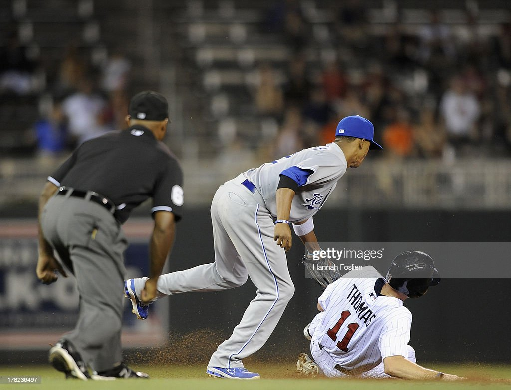 <a gi-track='captionPersonalityLinkClicked' href=/galleries/search?phrase=Alcides+Escobar&family=editorial&specificpeople=4845889 ng-click='$event.stopPropagation()'>Alcides Escobar</a> #2 of the Kansas City Royals catches <a gi-track='captionPersonalityLinkClicked' href=/galleries/search?phrase=Clete+Thomas&family=editorial&specificpeople=4952485 ng-click='$event.stopPropagation()'>Clete Thomas</a> #11 of the Minnesota Twins stealing second base during the eighth inning of the game on August 27, 2013 at Target Field in Minneapolis, Minnesota. The Royals defeated the Twins 6-1.