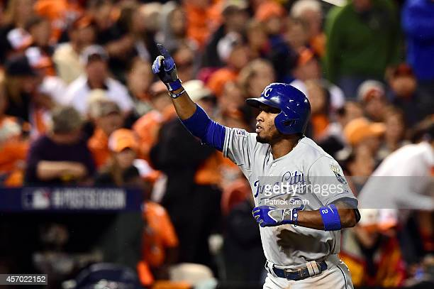 Alcides Escobar of the Kansas City Royals celebrates after hitting a solo home run to left field in the third inning against Chris Tillman of the...