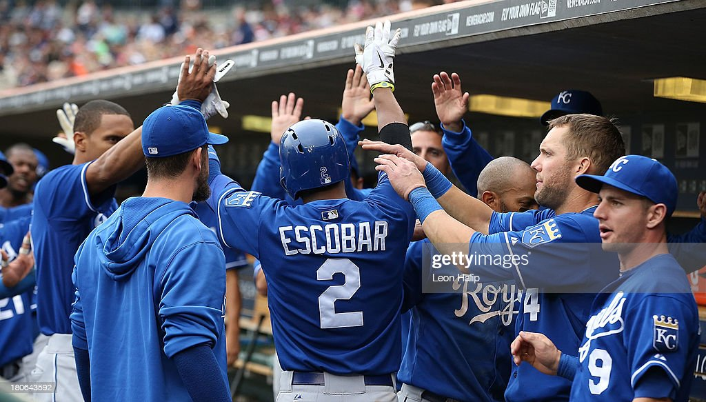 <a gi-track='captionPersonalityLinkClicked' href=/galleries/search?phrase=Alcides+Escobar&family=editorial&specificpeople=4845889 ng-click='$event.stopPropagation()'>Alcides Escobar</a> #2 of the Kansas City Royals celebrates after scoring on the wild pitch by <a gi-track='captionPersonalityLinkClicked' href=/galleries/search?phrase=Drew+Smyly&family=editorial&specificpeople=5928397 ng-click='$event.stopPropagation()'>Drew Smyly</a> #33 of the Detroit Tigers to tie the game in the eighth inning of the game at Comerica Park on September 15, 2013 in Detroit, Michigan.