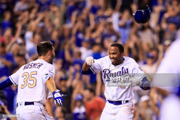 Alcides Escobar of the Kansas City Royals celebrates scoring the game winning run against the Chicago White Sox with Eric Hosmer in the tenth inning...