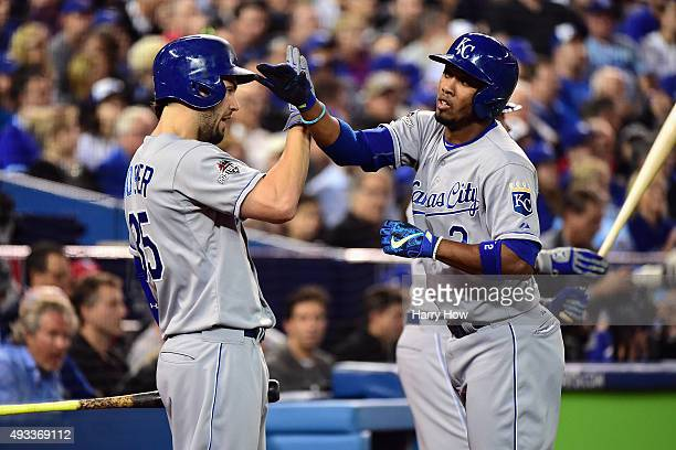 Alcides Escobar of the Kansas City Royals celebrates with Eric Hosmer of the Kansas City Royals after scoring a run in the first inning against the...