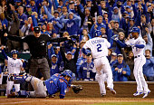 Alcides Escobar of the Kansas City Royals celebrates with Jarrod Dyson of the Kansas City Royals after scoring the gamewinning run in the fourteenth...