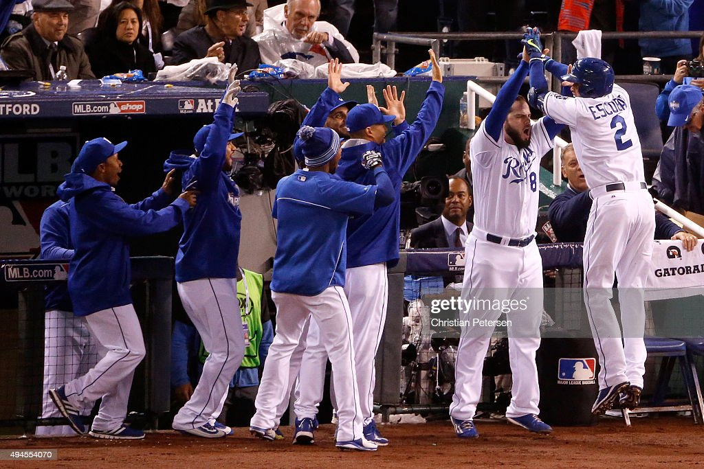 <a gi-track='captionPersonalityLinkClicked' href=/galleries/search?phrase=Alcides+Escobar&family=editorial&specificpeople=4845889 ng-click='$event.stopPropagation()'>Alcides Escobar</a> #2 of the Kansas City Royals celebrates with teammates after hitting an inside-the-park home run in the first inning against the New York Mets during Game One of the 2015 World Series at Kauffman Stadium on October 27, 2015 in Kansas City, Missouri.