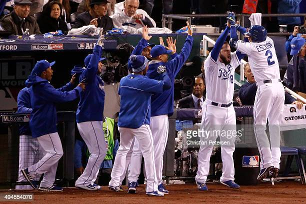 Alcides Escobar of the Kansas City Royals celebrates with teammates after hitting an insidethepark home run in the first inning against the New York...