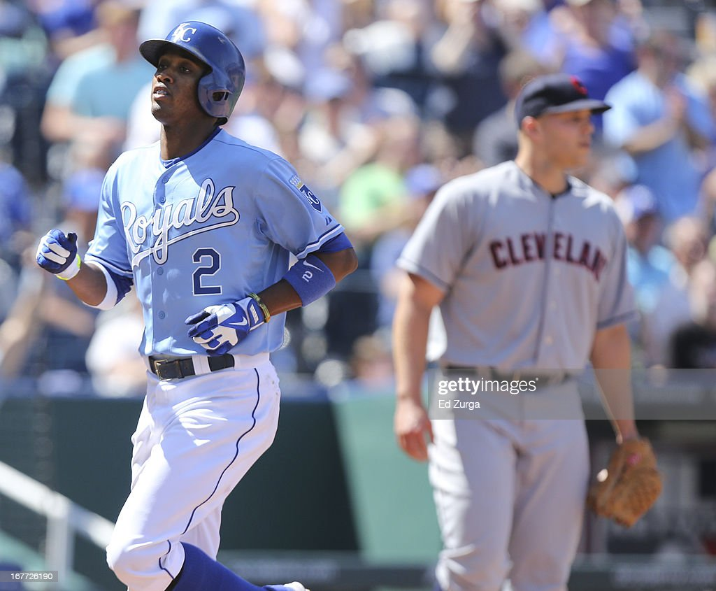 <a gi-track='captionPersonalityLinkClicked' href=/galleries/search?phrase=Alcides+Escobar&family=editorial&specificpeople=4845889 ng-click='$event.stopPropagation()'>Alcides Escobar</a> #2 of the Kansas City Royals crosses home as he scores on a Eric Hosmer single as <a gi-track='captionPersonalityLinkClicked' href=/galleries/search?phrase=Justin+Masterson&family=editorial&specificpeople=4950538 ng-click='$event.stopPropagation()'>Justin Masterson</a> #63 of the Cleveland Indians looks on in the seventh inning during game one of a doubleheader at Kauffman Stadium on April 28, 2013 in Kansas City, Missouri.