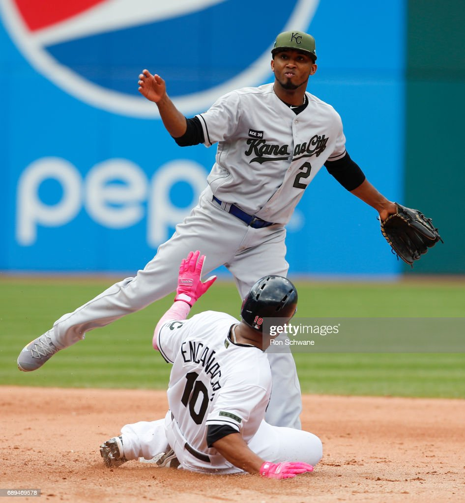 Alcides Escobar #2 of the Kansas City Royals forces out Edwin Encarnacion #10 of the Cleveland Indians at second base on a fielders choice by Jose Ramirez during the fifth inning at Progressive Field on May 28, 2017 in Cleveland, Ohio. The Indians defeated the Royals 10-1.