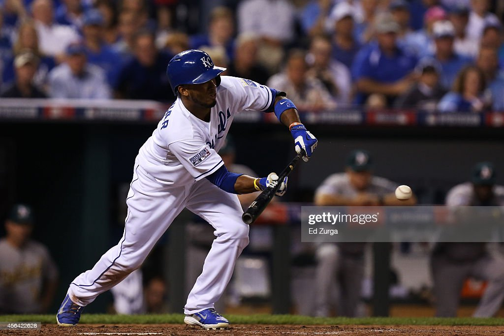 Alcides Escobar of the Kansas City Royals hits a sacrafice bunt in the third inning against Oakland Athletics during the American League Wild Card...