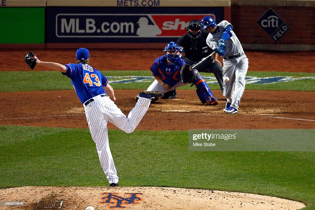 Alcides Escobar of the Kansas City Royals hits an hits an RBI double in the 12th inning against Addison Reed of the New York Mets during Game Five of...