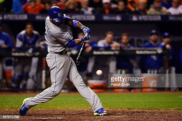 Alcides Escobar of the Kansas City Royals hits an RBI double in the ninth inning against Zach Britton of the Baltimore Orioles during Game Two of the...