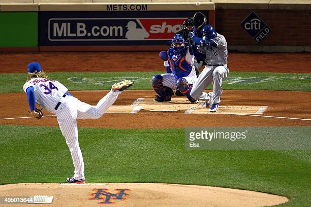 Alcides Escobar of the Kansas City Royals is brushed back by a pitch from Noah Syndergaard of the New York Mets in the first inning during Game Three...
