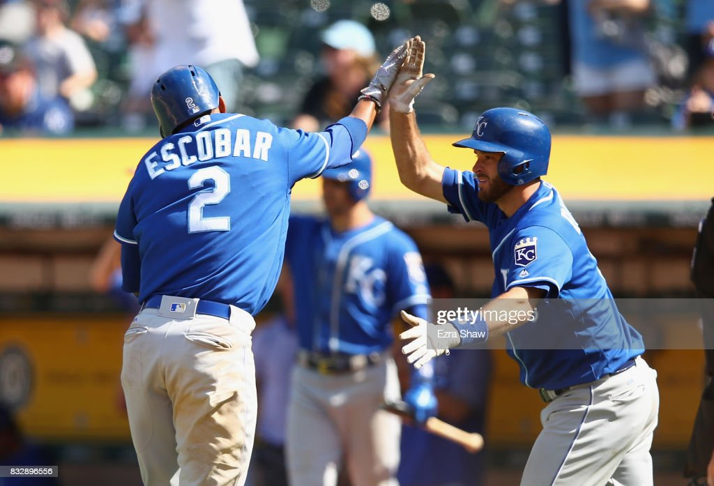 Alcides Escobar #2 of the Kansas City Royals is congratulated by Drew Butera #9 after he scored in the ninth inning against the Oakland Athletics at Oakland Alameda Coliseum on August 16, 2017 in Oakland, California.