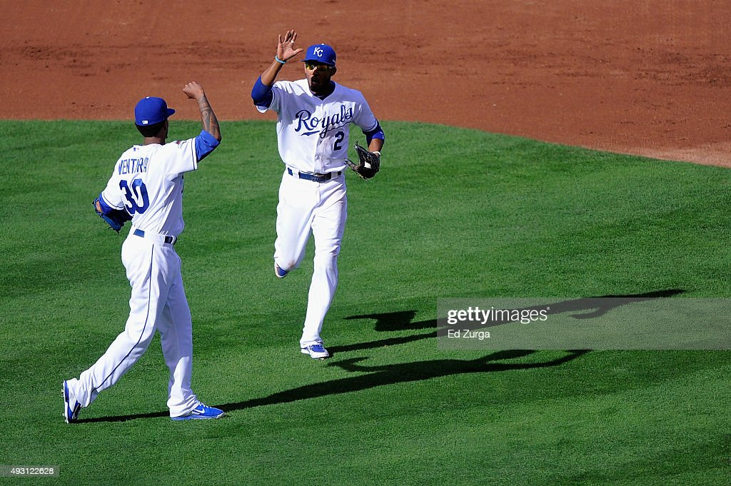 <a gi-track='captionPersonalityLinkClicked' href=/galleries/search?phrase=Alcides+Escobar&family=editorial&specificpeople=4845889 ng-click='$event.stopPropagation()'>Alcides Escobar</a> #2 of the Kansas City Royals is high fived by <a gi-track='captionPersonalityLinkClicked' href=/galleries/search?phrase=Yordano+Ventura&family=editorial&specificpeople=9527243 ng-click='$event.stopPropagation()'>Yordano Ventura</a> #30 of the Kansas City Royals after the second inning against the Toronto Blue Jays in game two of the American League Championship Series at Kauffman Stadium on October 17, 2015 in Kansas City, Missouri.