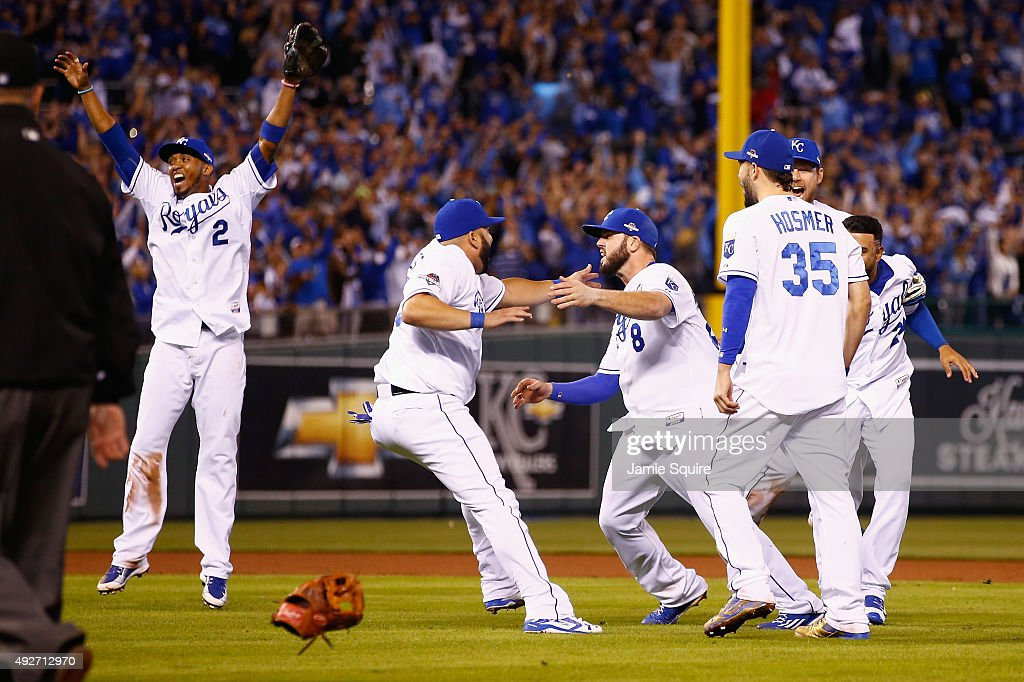 Alcides Escobar #2 of the Kansas City Royals, Kendrys Morales #25 of the Kansas City Royals, Mike Moustakas #8 of the Kansas City Royals, and Eric Hosmer #35 of the Kansas City Royals celebrate defeating the Houston Astros 7-2 in game five of the American League Divison Series at Kauffman Stadium on October 14, 2015 in Kansas City, Missouri.