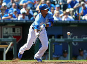 Alcides Escobar of the Kansas City Royals lays down a bunt in the sixth inning of a game against the Oakland Athletics at Kauffman Stadium on August...