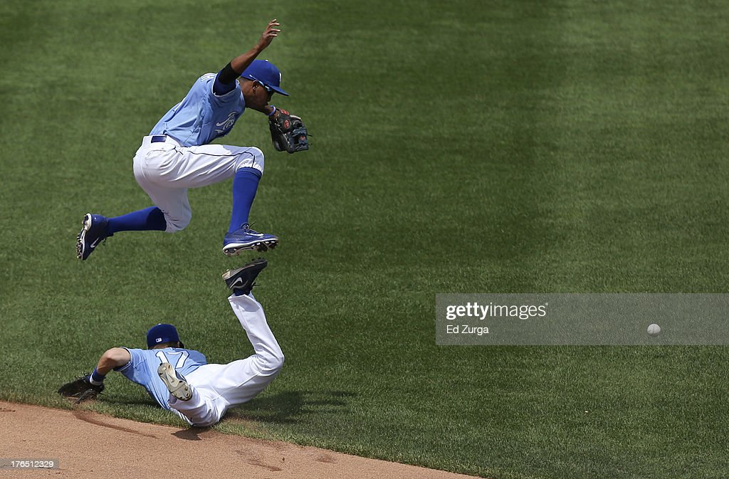<a gi-track='captionPersonalityLinkClicked' href=/galleries/search?phrase=Alcides+Escobar&family=editorial&specificpeople=4845889 ng-click='$event.stopPropagation()'>Alcides Escobar</a> #2 of the Kansas City Royals leaps over <a gi-track='captionPersonalityLinkClicked' href=/galleries/search?phrase=Chris+Getz&family=editorial&specificpeople=4936717 ng-click='$event.stopPropagation()'>Chris Getz</a> as they chase a hit by Justin Ruggiano of the Miami Marlins in the fourth inning at Kauffman Stadium August 14, 2013 in Kansas City, Missouri. Adeiny Hechavarria scored on the hit.