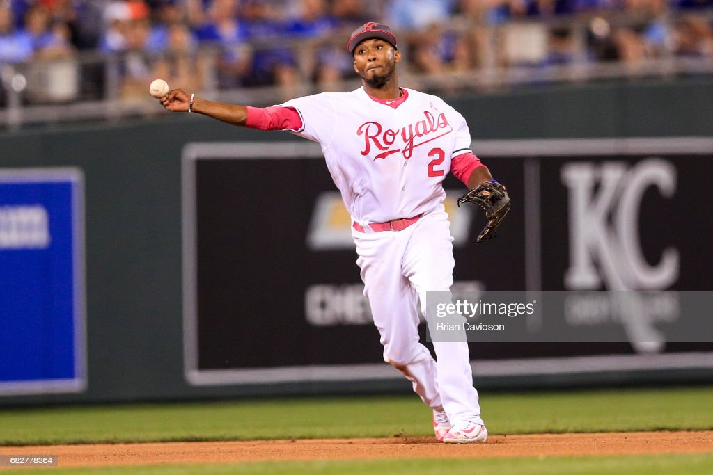 Alcides Escobar #2 of the Kansas City Royals makes a play to first for an out against the Baltimore Orioles during the eighth inning at Kauffman Stadium on May 13, 2017 in Kansas City, Missouri. Players are wearing pink to celebrate Mother's Day weekend and support breast cancer awareness.