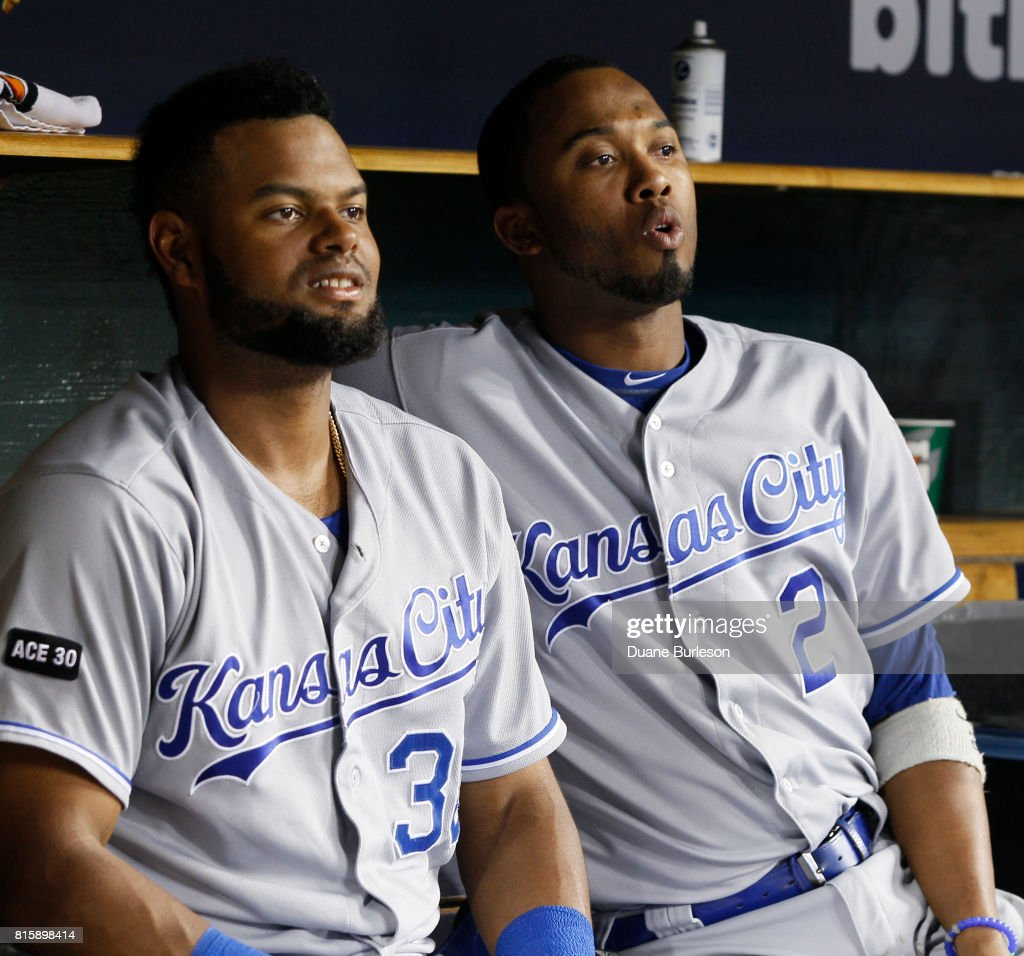 Alcides Escobar #2 of the Kansas City Royals reacts to a hit by a teammate while sitting with Jorge Bonifacio #38 of the Kansas City Royals during a game against the Detroit Tigers at Comerica Park on June 28, 2017 in Detroit, Michigan.