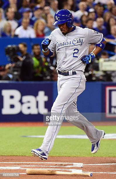 Alcides Escobar of the Kansas City Royals scores a run in the first inning against the Toronto Blue Jays during game three of the American League...