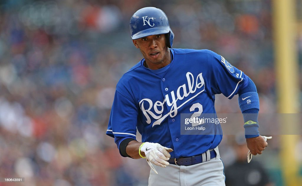 <a gi-track='captionPersonalityLinkClicked' href=/galleries/search?phrase=Alcides+Escobar&family=editorial&specificpeople=4845889 ng-click='$event.stopPropagation()'>Alcides Escobar</a> #2 of the Kansas City Royals scores on the wild pitch by <a gi-track='captionPersonalityLinkClicked' href=/galleries/search?phrase=Drew+Smyly&family=editorial&specificpeople=5928397 ng-click='$event.stopPropagation()'>Drew Smyly</a> #33 of the Detroit Tigers to tie the game in the eighth inning of the game at Comerica Park on September 15, 2013 in Detroit, Michigan.