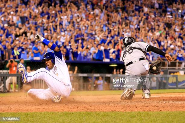 Alcides Escobar of the Kansas City Royals scores the game winning run against the Chicago White Sox during the tenth inning at Kauffman Stadium on...