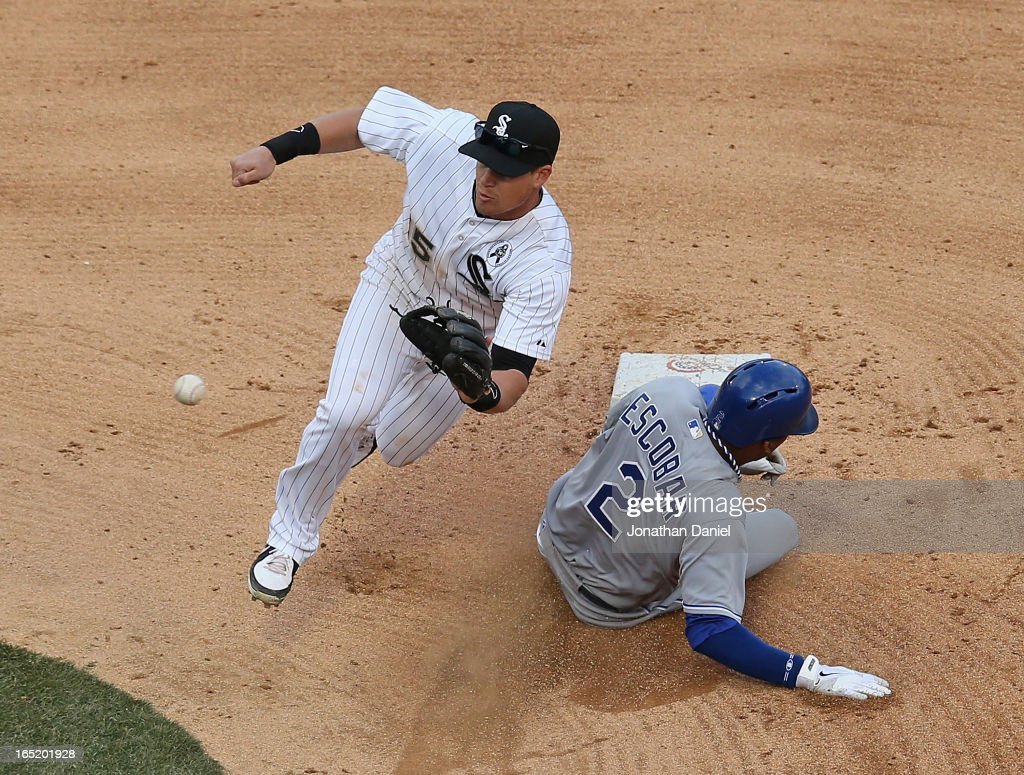 Alcides Escobar #2 of the Kansas City Royals steals second base as Gordon Beckham #15 of the Chicago White Sox awaits the throw during the Opening Day game at U.S. Cellular Field on April 1, 2013 in Chicago, Illinois. The White Sox defeated the Royals 1-0.
