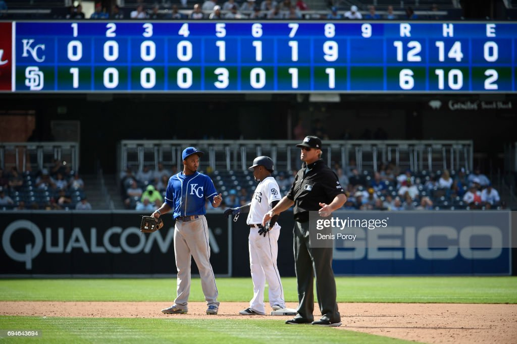 Alcides Escobar #2 of the Kansas City Royals talks with Erick Aybar #8 of the San Diego Padres during an eighth inning pitching change in a baseball game at PETCO Park on June 10, 2017 in San Diego, California.