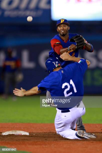Alcides Escobar of Venezuela throws to first after tagging out Rob Segedin of Italy in the bottom of the eighth inning during the World Baseball...