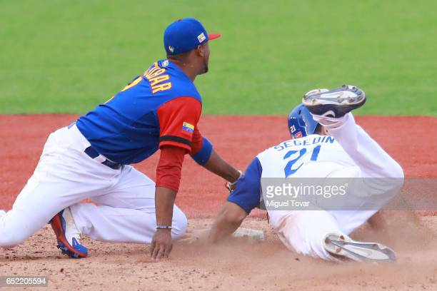 Alcides Escobar#2 of Venezuela tags out Rob Segedin of Italy in the bottom of the seventh inning during the World Baseball Classic Pool D Game 3...