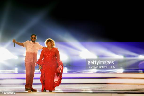 Alcione and Emicida perform on stage before the Final Draw for the 2014 FIFA World Cup Brazil at Costa do Sauipe Resort on December 6 2013 in Costa...