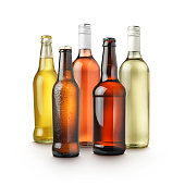 group shot of a variety of alcohol bottles on white background