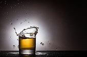 Alcohol splash in glass