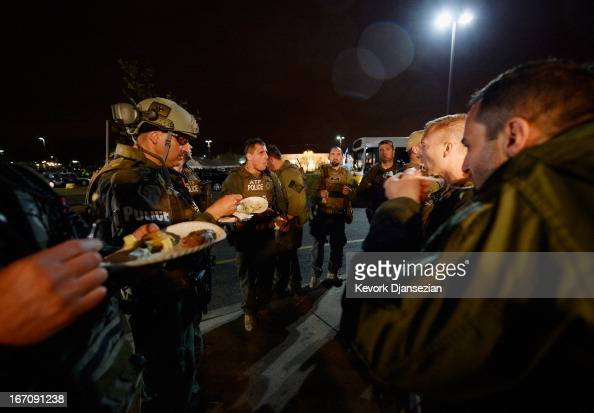 Alcohol Tobacco and Firearm police relax with a meal following the apprehension earlier of the second suspect in the Boston Marathon bombing on April...