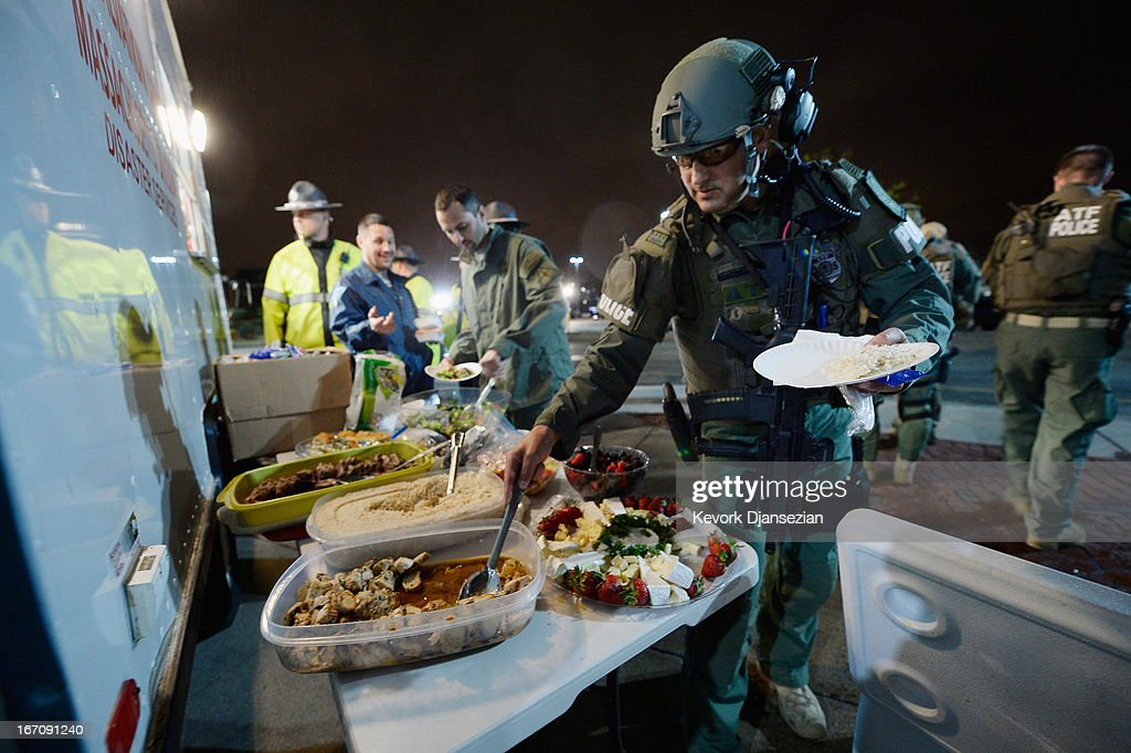 Alcohol, Tobacco and Firearm police relax with a meal following the apprehension earlier of the second suspect in the Boston Marathon bombing on April 19, 2013 in Watertown, Massachusetts. A manhunt for a suspect in the Boston Marathon bombing, Dzhokhar A. Tsarnaev, 19, ended this evening with his capture on a boat parked on a residential property in Watertown, Massachusetts. His brother Tamerlan Tsarnaev, 26, the other suspect, was shot and killed by police early this morning after a car chase and shootout with police. The two men are suspects in the bombings at the Boston Marathon on April 15 that killed three people and wounded at least 170.
