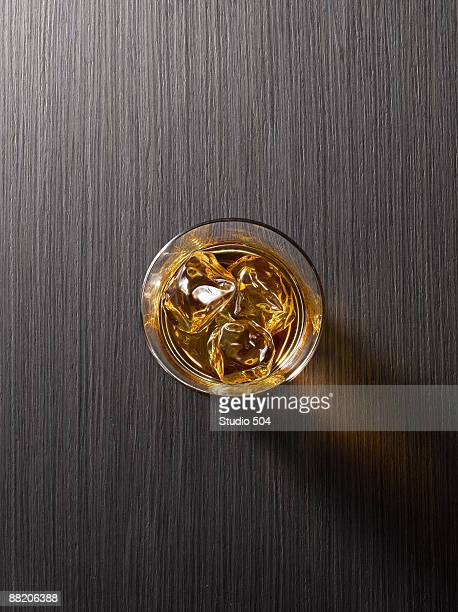 Alcoholic Drink with ice on black surface