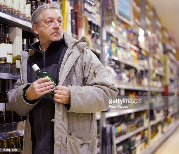 Alcoholic stealing gin from supermarket