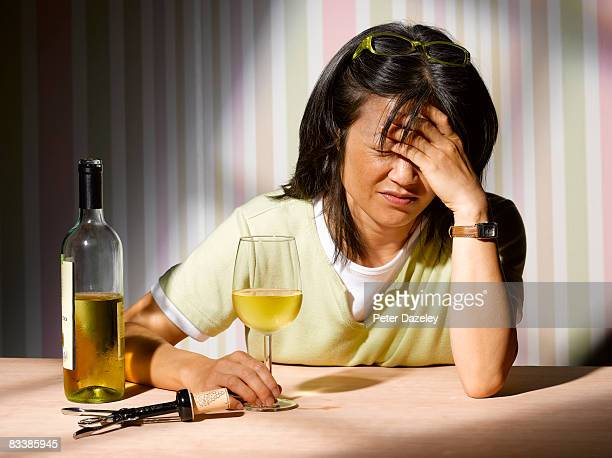 Alcoholic woman with wine