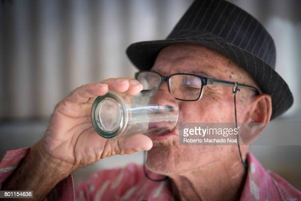 Alcoholism Cuban senior man drinking rum in the afternoon Rum is cheap in the Caribbean island
