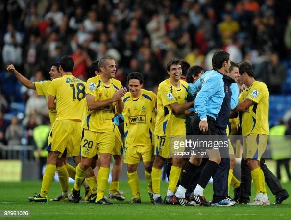 Alcorcon players celebrate after eliminating Real Madrid at the end of the Copa del Rey fourth round second leg match between Real Madrid and AD...