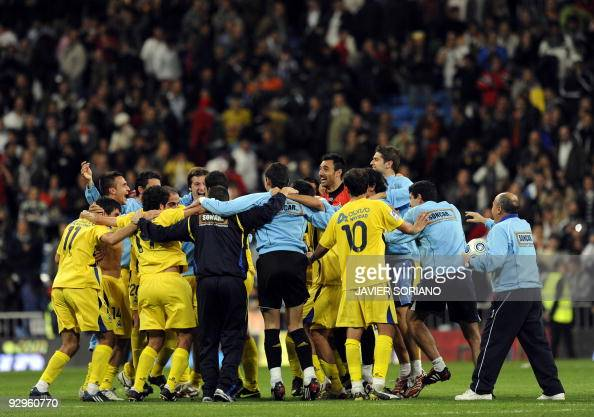 Alcorcon players celebrate after their Spanish King Cup football match against Real Madrid at Santiago Bernabeu stadium on November in Madrid Real...