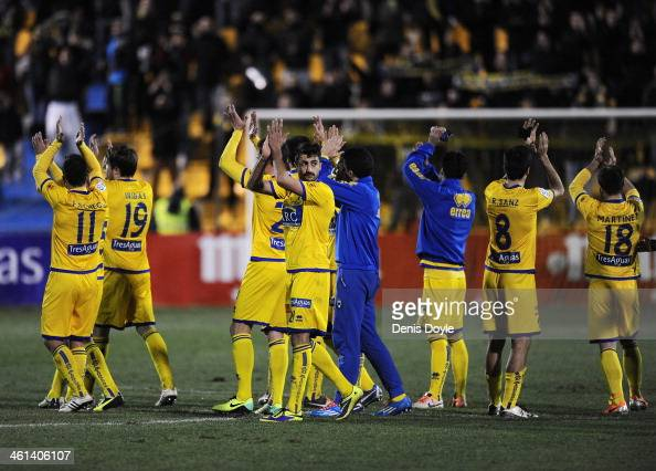 Alcorcon players celebrate after their team beat Espanyol 10 in the Copa del Rey Round of 16 1st leg match between Alcorcon and Espanyol at Estadio...