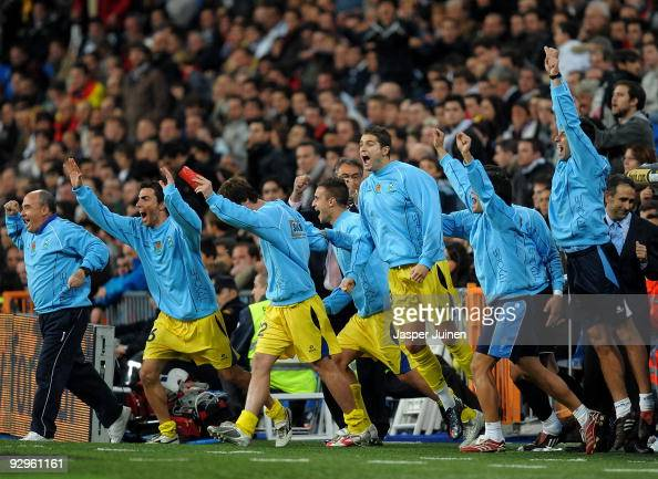 Alcorcon players jump off the bench celebrating after eliminating Real Madrid at the end of the Copa del Rey fourth round second leg match between...