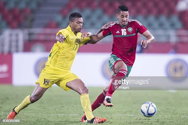 Aldaar Cruz dos Santos of Sao Tome e Principe Mourad Batna of Morocco during the Africa Cup of Nations match between Morocco and Sao Tome E Principe...