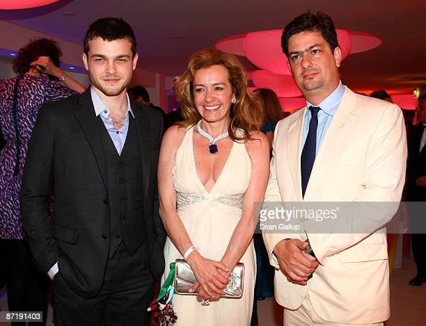 Alden Ehrenreich Caroline GruosiScheufele and Roman Coppola arrive at the Chopard Perfume Launch/Cascade Perfume Party at the Eden Rock during the...