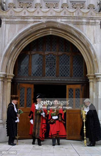 Alderman Sir David Howard centre left the current Lord Mayor of the City of London walks out of Guildhall London with his successor Alderman Michael...