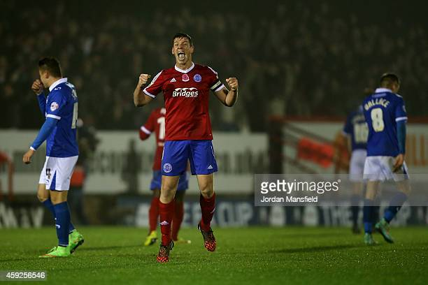 Aldershot captain Glenn Wilson celebrates at the final whistle during the FA Cup First Round Replay match between Aldershot Town and Portsmouth at...