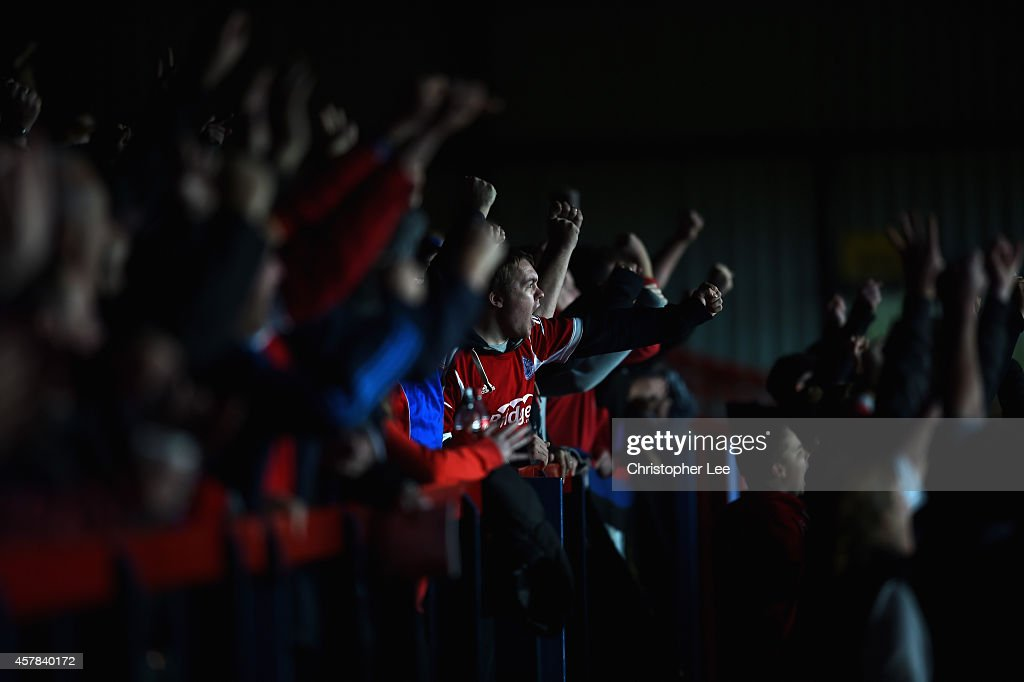 Aldershot fans celebrates their second goal during the FA Cup Qualifying Fourth Round match bteween Aldershot Town and Torquay United at The...