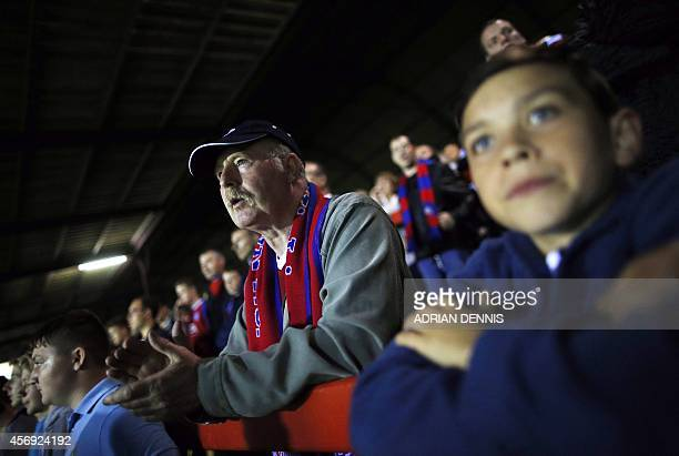 Aldershot fans cheer for their football team during the Vanarama Conference local derby football match between Aldershot and Woking at The Electrical...