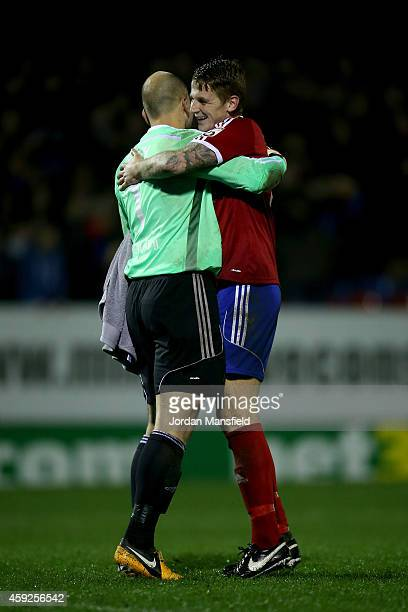 Aldershot Goalkeeper Phil Smith celebrates with Joe Oaslter after their win in the FA Cup First Round Replay match between Aldershot Town and...