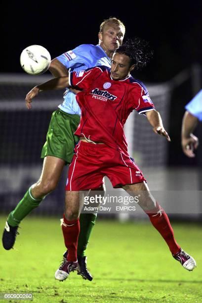 Aldershot Town's Hugh McAuley and Gravesend Northfleet's Justin Skinner battle for the ball